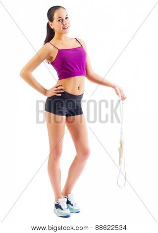 Sporty girl with skipping rope isolated