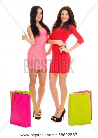 Two young girls with bags isolated