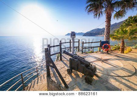 Cannon on the coastline of Ligurian Sea, Italy
