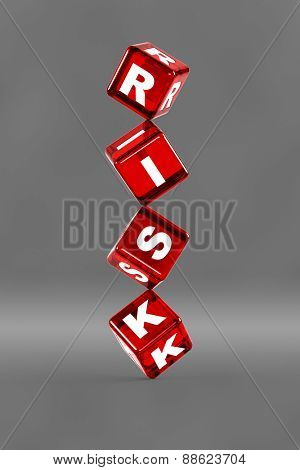Balancing dice with letters on them spelling