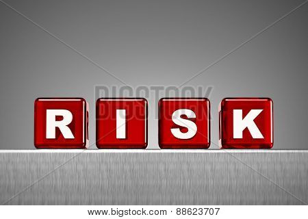 Red semi transparent dice spelling the word risk on metal surface with gradient background