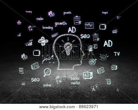 Advertising concept: Head With Lightbulb in grunge dark room