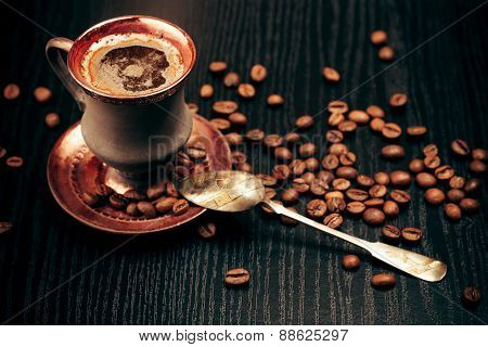 Vintage cup of coffee with spoon, closeup