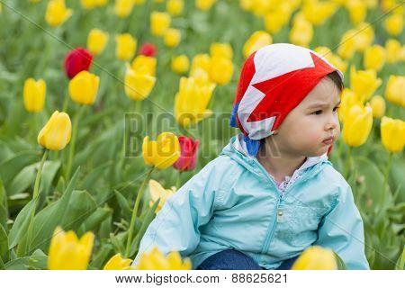 Beautiful Little Girl On A Field Of Tulips