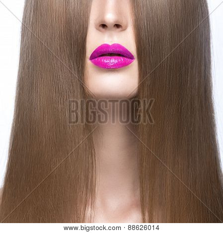 Beautiful girl with a perfectly smooth hair and pink lips. Beauty face.