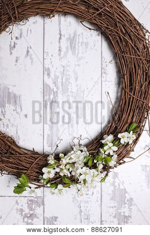 Apple blossom garland hanging on wooden door