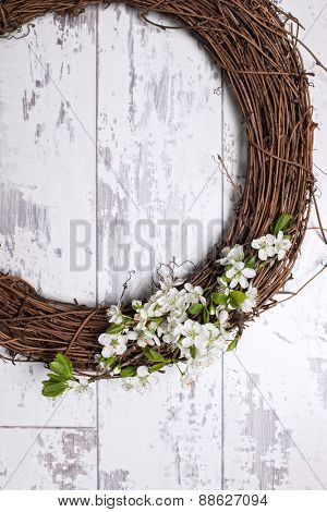 Apple blossom garland on white wooden door