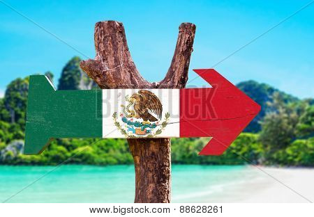 Mexico Flag wooden sign with beach background
