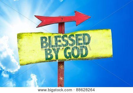 Blessed By God sign with sky background