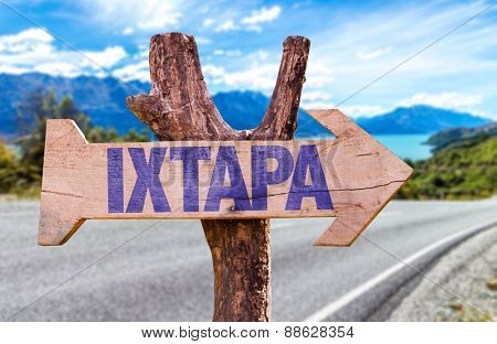 Ixtapa wooden sign with road background