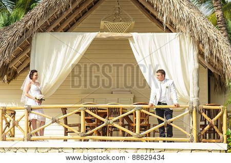 Young loving couple on tropical sea background - wedding at the beach.