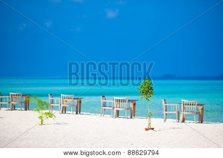 Summer empty open air cafe near sea on the beach