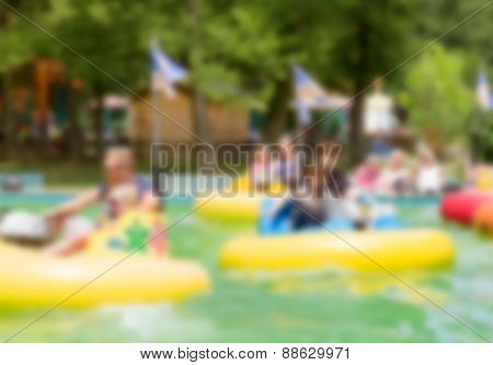 Abstract blurred image of an amusement park for background