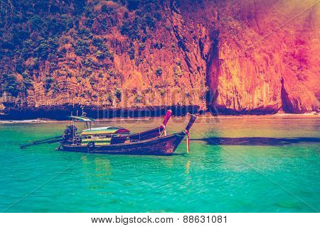 Traditional wooden boat in a tropical bay on Koh Phi Phi Island, Thailand, Asia