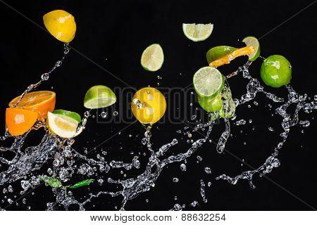 Fresh  fruits with water splash isolated on black background