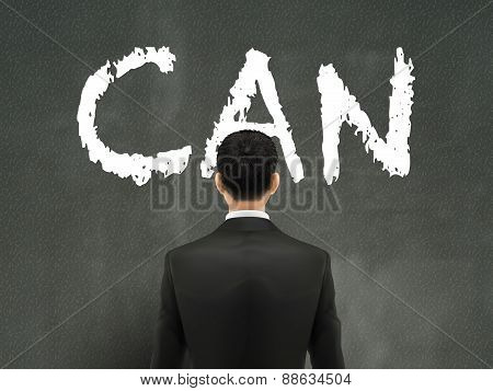 Businessman Looking At Can Word