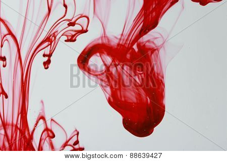 Red Ink  Liquid In Water Making Abstract Forms