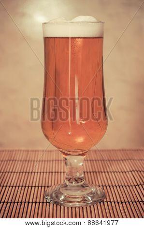 Full glass of beer - vintage shot