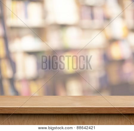 empty wood shelf for product display in book shop or library