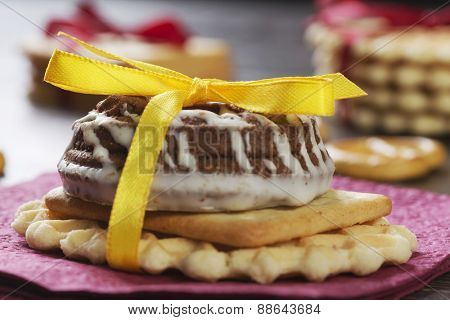 Stack of delicious cookies on table tied with ribbon