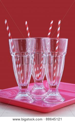 Empty Soda Pop Glasses With Straws.
