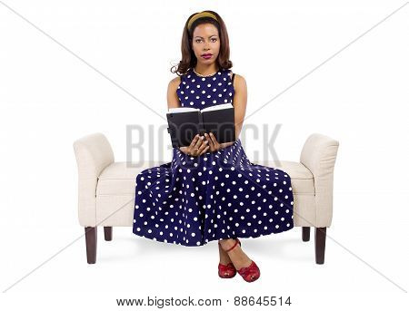 Retro Black Girl Reading on a Couch