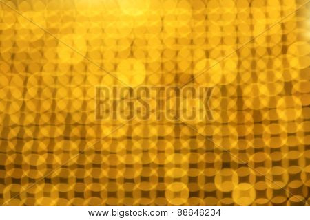 Gold reflection bokeh abstract background. Intentionally off focus bokeh background.