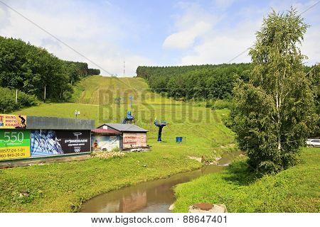 Ski slopes and lifts in summer. Mountain Tserkovka at the Belokuriha.