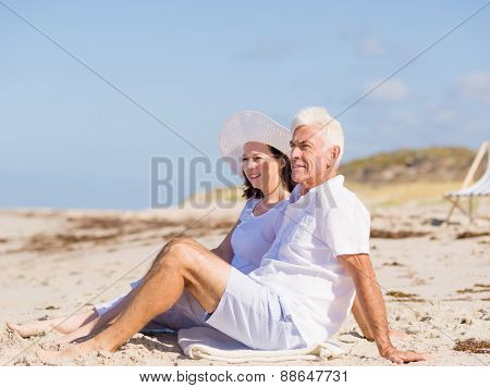 Couple sitting on the beach