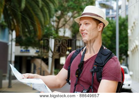 Happy young man with a map