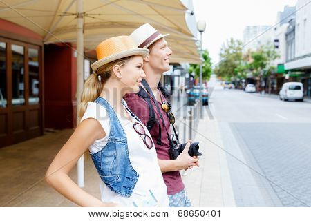 Happy young couple exploring city