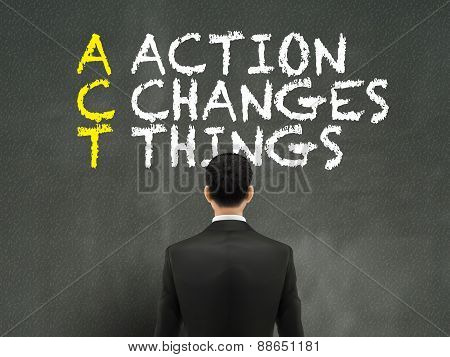 Businessman Looking At Act Word