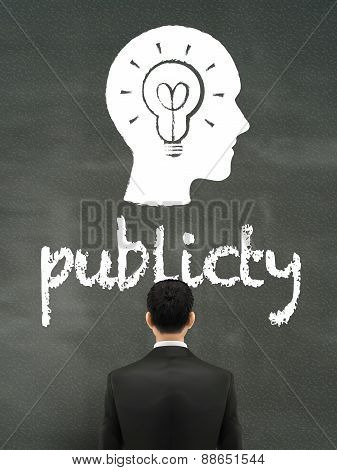 Businessman Looking At Publicity Word
