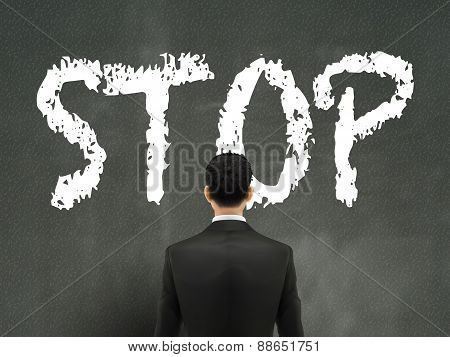 Businessman Looking At Stop Word