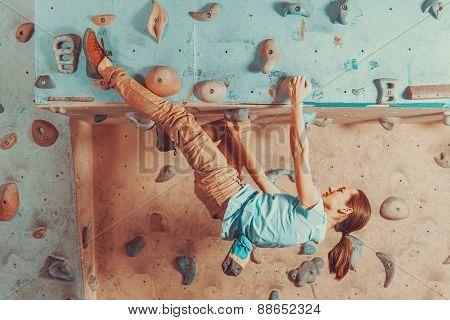 Woman Training On Practice Climbing Wall