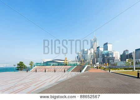 Empty footpath with cityscape at far away