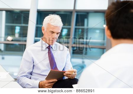 Two businessmen during interview in office