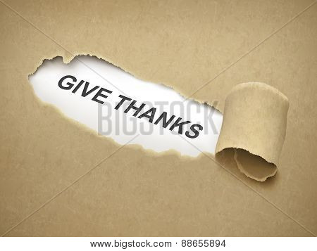 Give Thanks Words Behind Torn Paper
