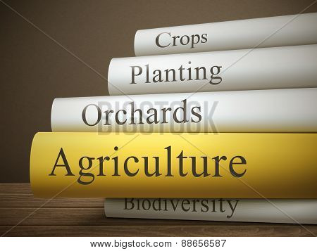 Book Title Of Agriculture Isolated On A Wooden Table