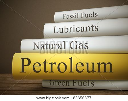 Book Title Of Petroleum Isolated On A Wooden Table