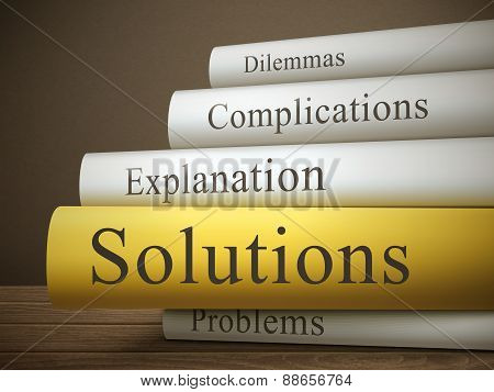 Book Title Of Solutions Isolated On A Wooden Table
