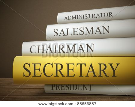 Book Title Of Secretary Isolated On A Wooden Table