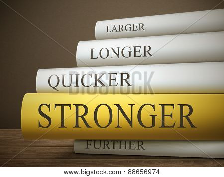 Book Title Of Stronger Isolated On A Wooden Table