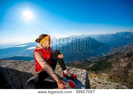 Sport woman resting on the mountain