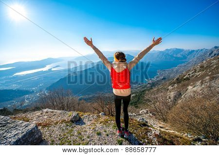 Sport woman on the top of mountain