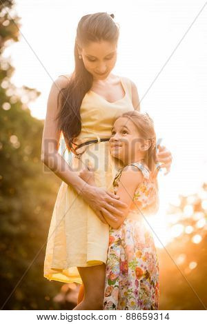 Mother and child at sunset