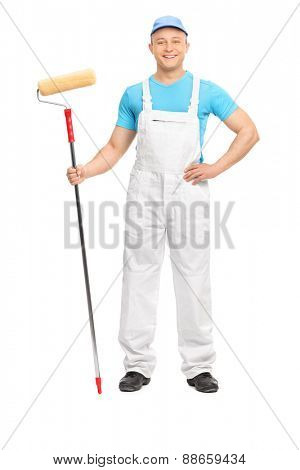 Full length portrait of a male decorator posing with a paint roller isolated on white background