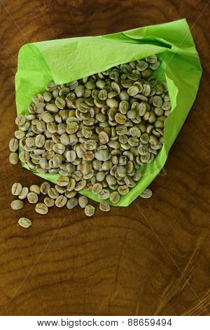 green (white) coffee beans on wooden background