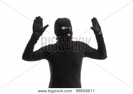 Thief in black costume surrendering to someone isolated on white background