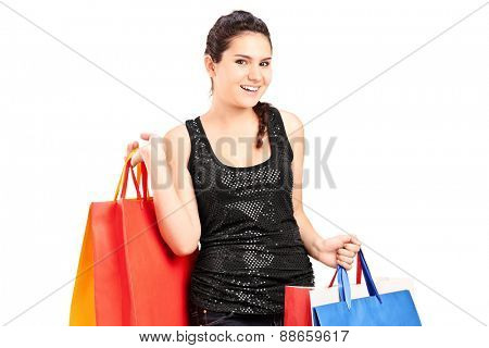 Fashionable female holding bunch of shopping bags isolated on white background